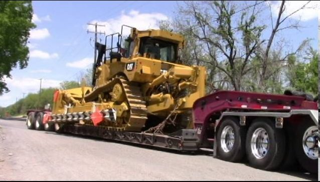Bulldozer on a heavy equipment transport